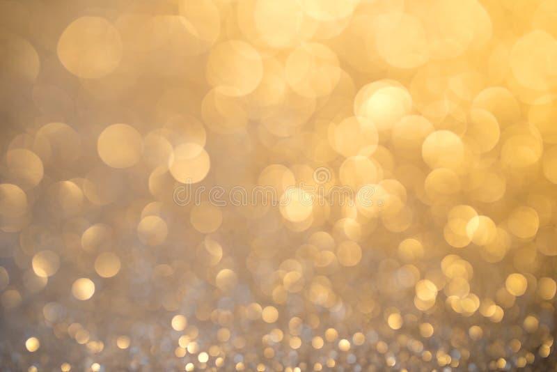 银色在金黄光的闪烁圣诞节抽象背景 库存图片