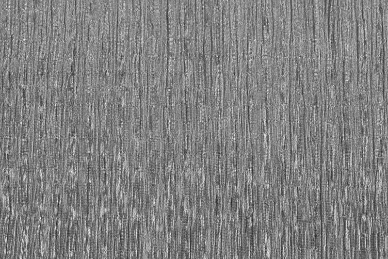 银色暗淡织地不很细布料背景 库存图片