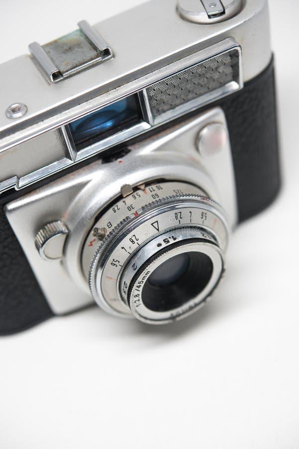 银色照相机老照片白色背景,卷轴照相机 免版税库存照片