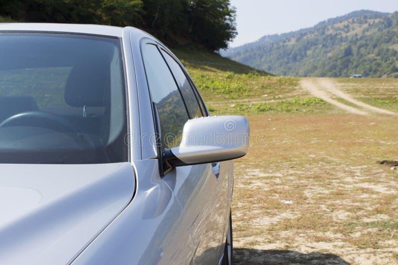 银色现代跑车的左零件 图库摄影