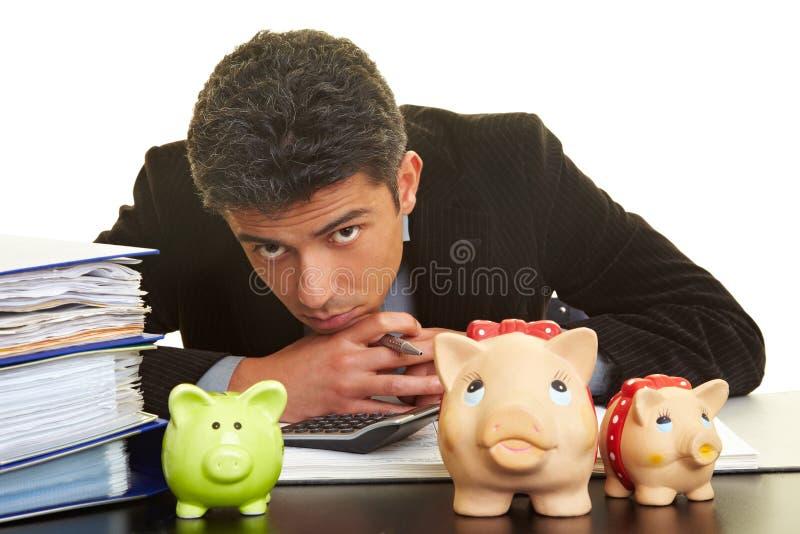银行供以人员贪心 免版税库存照片