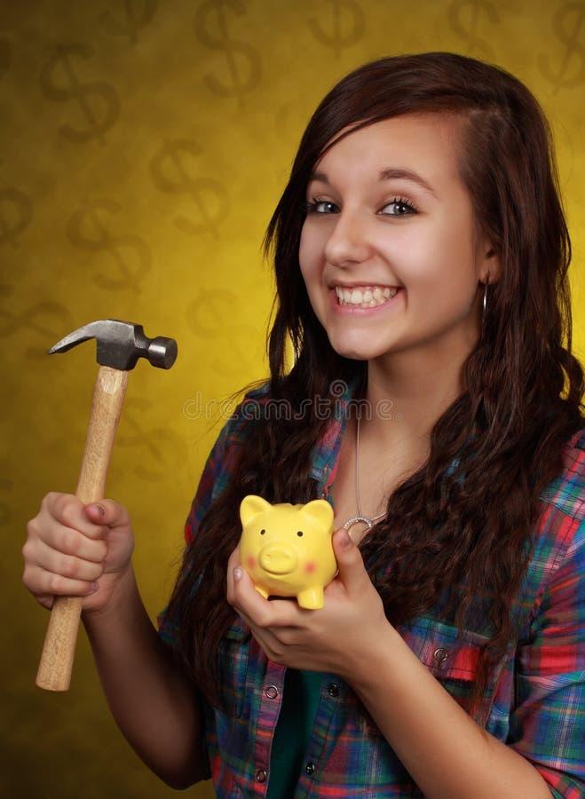 银行女孩藏品青少年的佩吉 免版税图库摄影