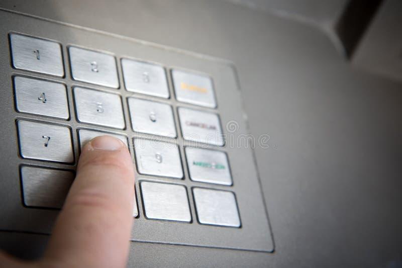 银行编码手指按 库存照片