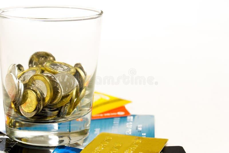铸造玻璃在信用卡顶部 免版税图库摄影