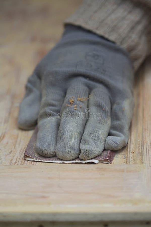 铺沙的木头 图库摄影