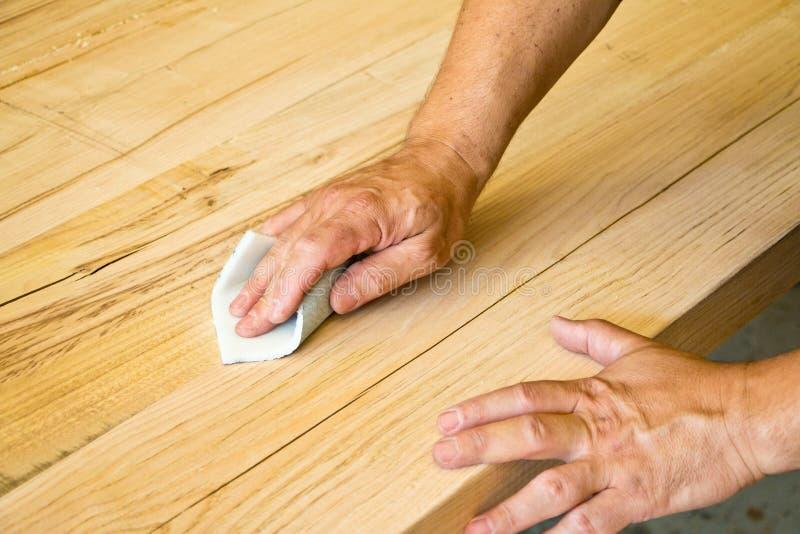 铺沙的木头 免版税库存图片