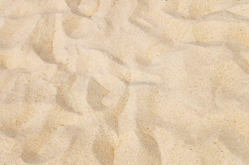 铺沙纹理黄色 库存图片