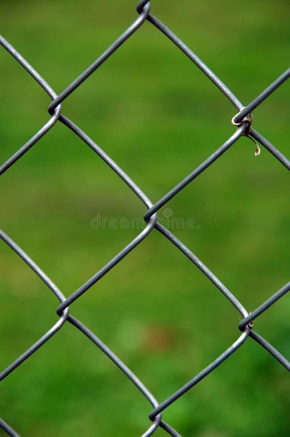 链节篱芭,绿色背景 免版税库存图片