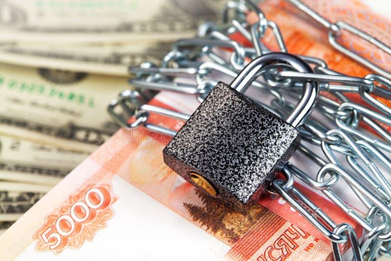 锁定货币 图库摄影