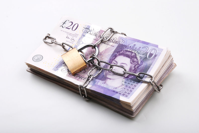 锁着的货币 图库摄影