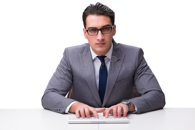 键入在键盘的年轻商人隔绝在白色backgro 免版税库存图片