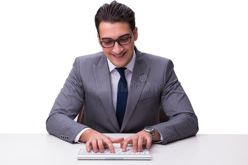 键入在键盘的年轻商人隔绝在白色backgro 库存照片