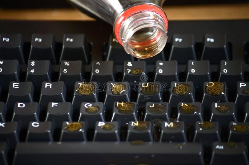 键盘苏打溢出 库存图片