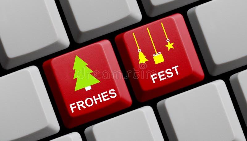 键盘:圣诞快乐德语 免版税库存照片