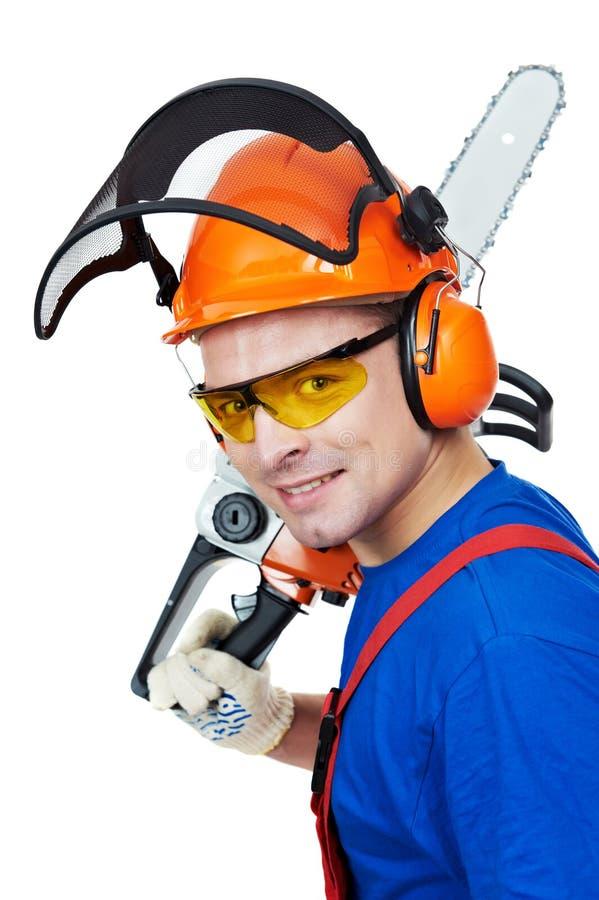 锯查出的伐木工人工作者 免版税库存图片