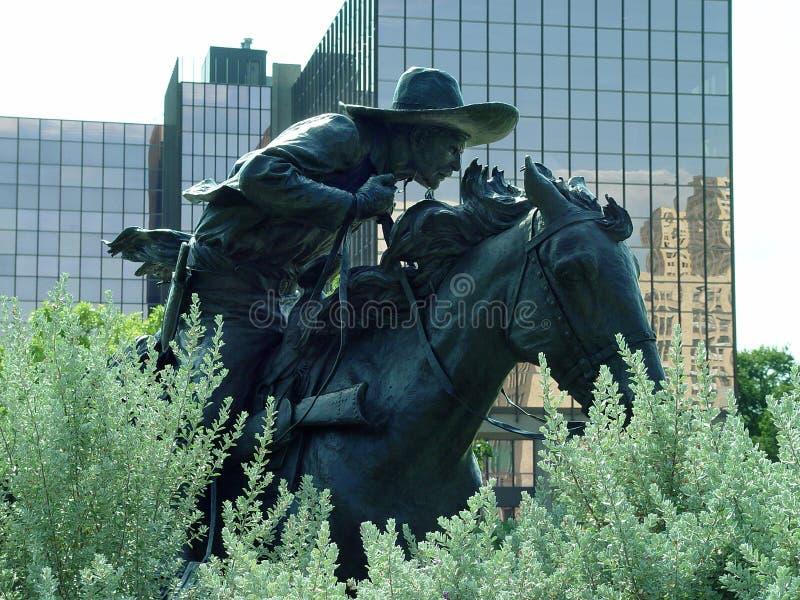 镀青铜牛仔 免版税库存图片