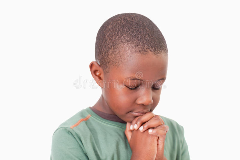 镇静男孩祈祷 库存图片