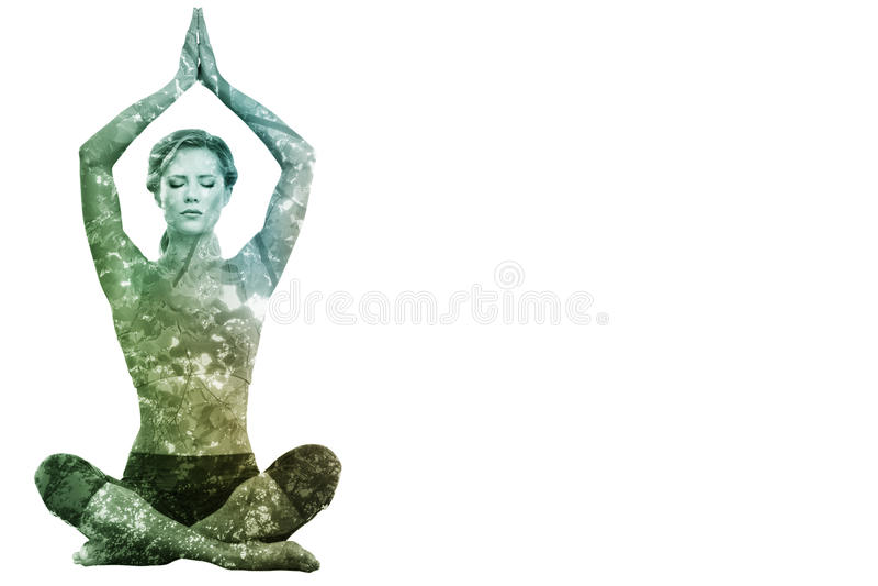 镇静白肤金发思考的综合图象在与被举的胳膊的莲花姿势 免版税图库摄影