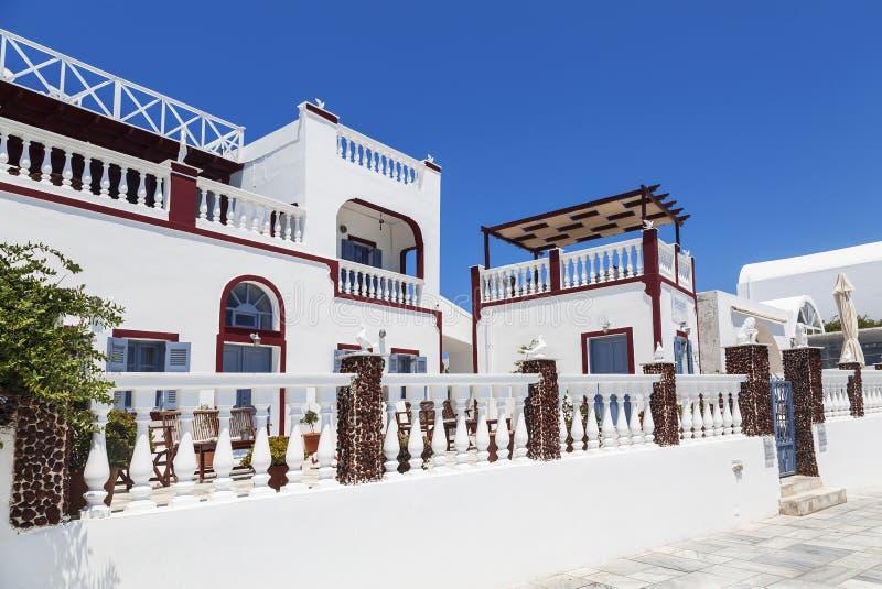 镇Oia的美好的建筑学在圣托里尼海岛上的  免版税图库摄影