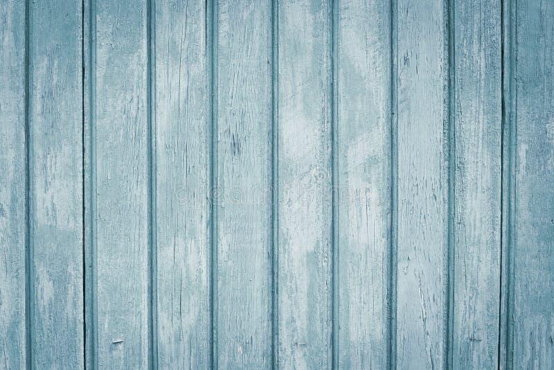 镶边灰色木表面 有钉子的破旧的浅灰色和蓝色篱芭 木墙壁背景,老板条,木条地板,桌 Vintag 免版税图库摄影