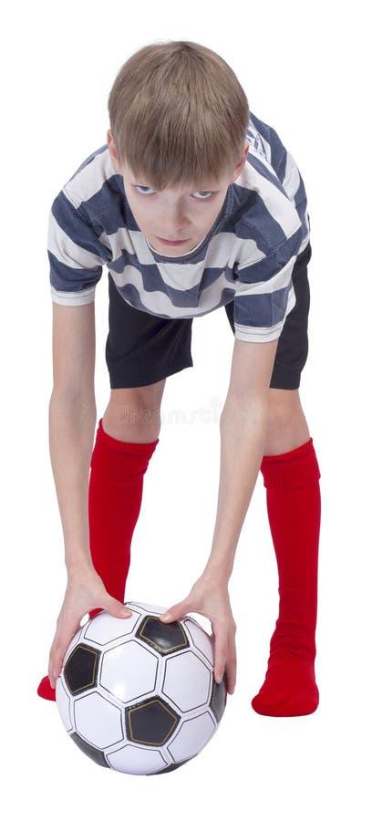 镶边T恤杉的年轻足球运动员 库存图片