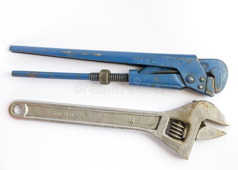 长凳工具和一把可调整的管扳手 免版税图库摄影