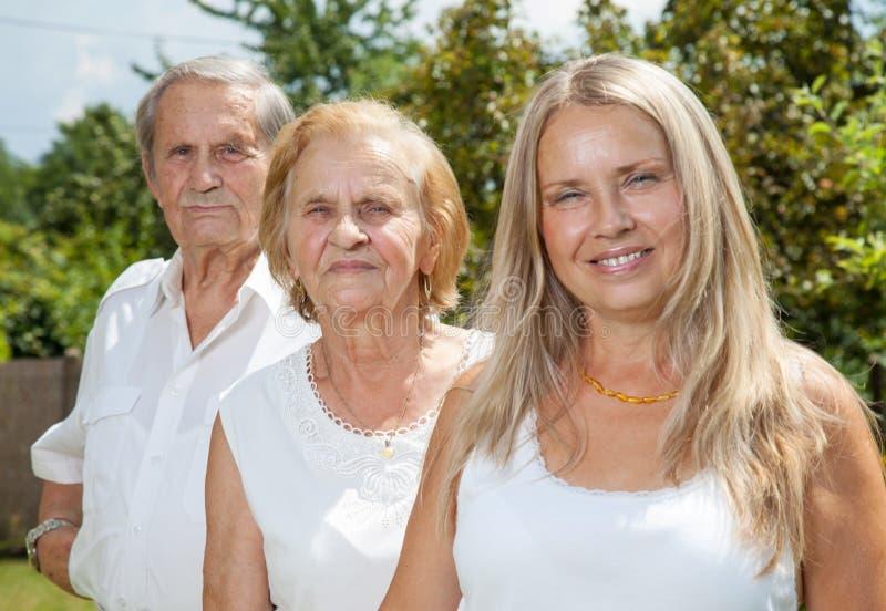 年长夫妇和他们的女儿 免版税库存照片