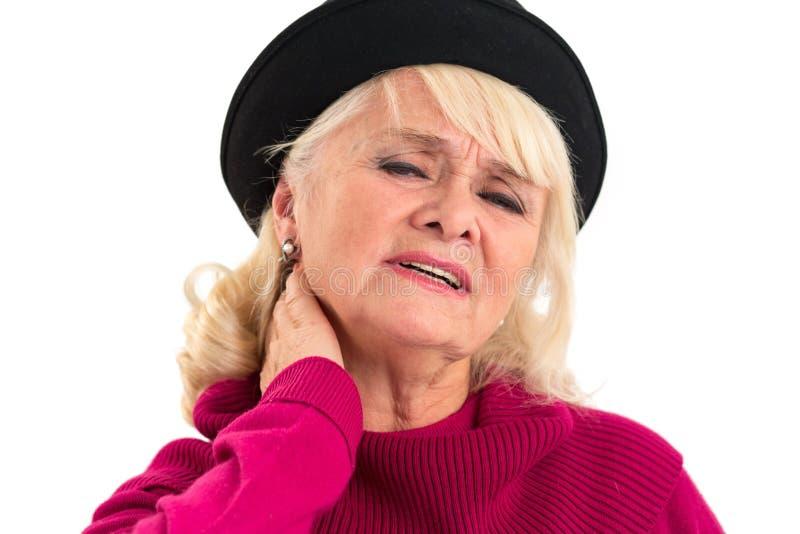 年长妇女有脖子疼痛 免版税库存照片