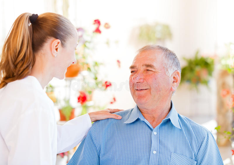 年长家庭护理 免版税库存图片
