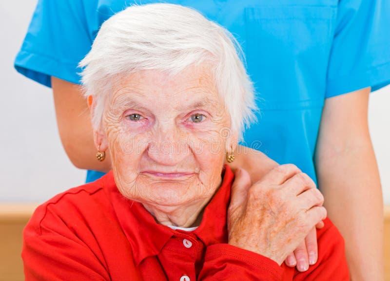 年长家庭护理 免版税图库摄影