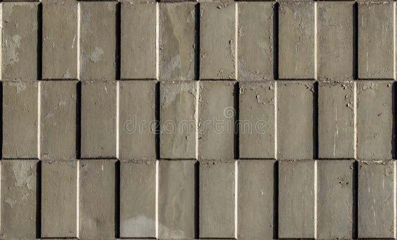 长方形压印的被仿造的块墙壁 库存图片