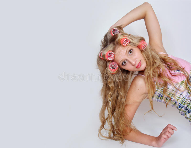 长期卷发的人公平的女孩头发 库存图片