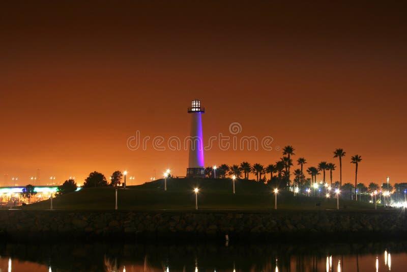 长期海滩灯塔紫色 图库摄影