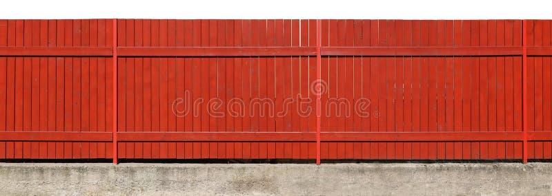 长期深深桔子绘了在具体bas的坚实木篱芭 免版税库存照片