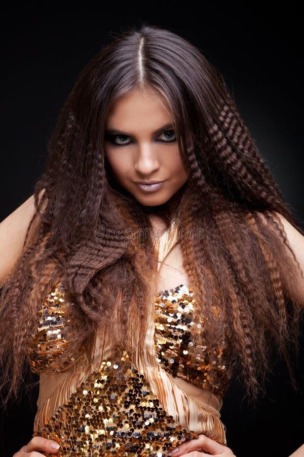 长期美丽的深色的头发 图库摄影