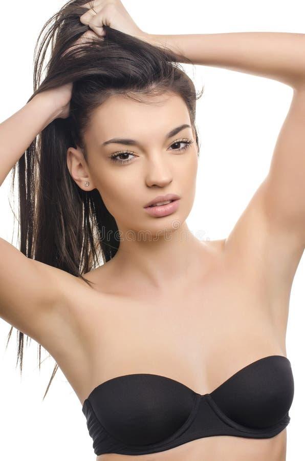 长期美丽的深色的女孩头发 秀丽查出的纵向白色 免版税库存图片