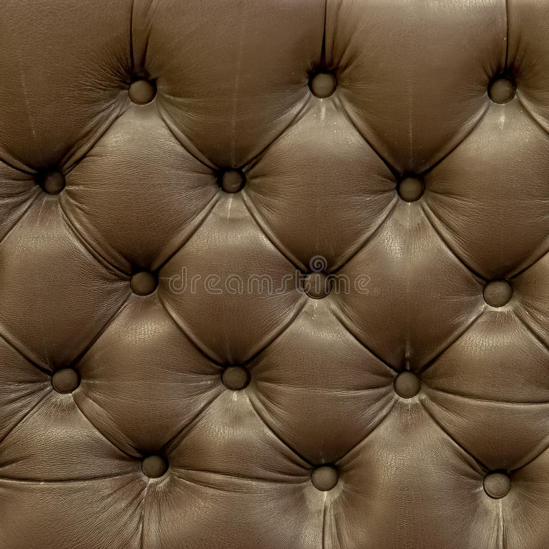长沙发皮革老纹理室内装潢 免版税库存图片