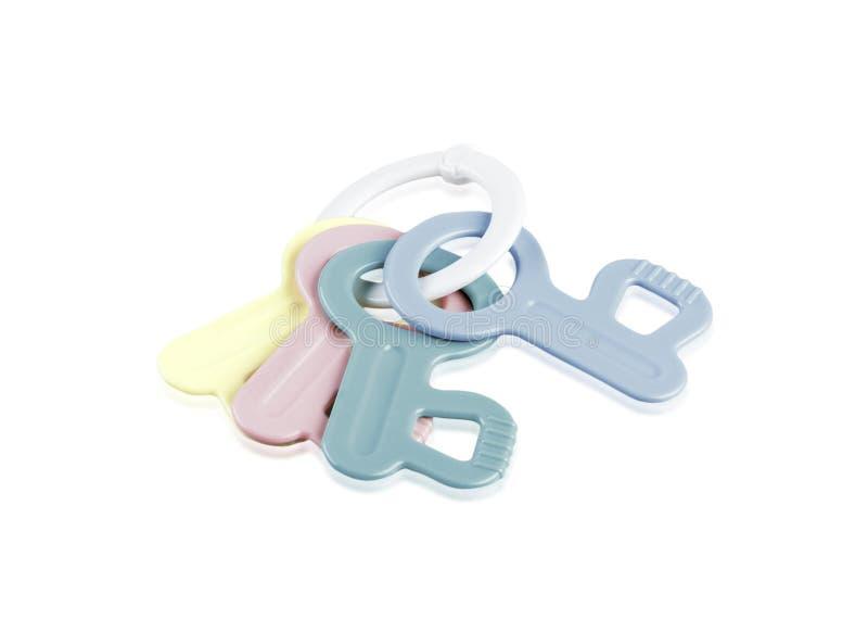 长牙齿的,在圆环的钥匙婴孩玩具 库存照片