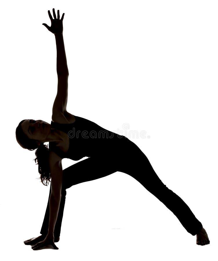 延长的侧角姿势的妇女在瑜伽 库存照片