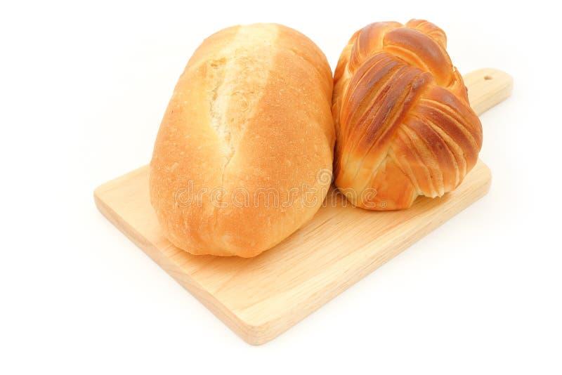 长的转弯蜂蜜丹麦酥皮点心和黄油丹麦酥皮点心 免版税库存照片