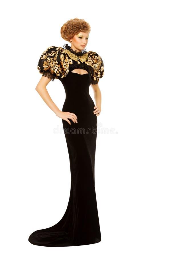长的黑豪华时尚礼服的妇女在白色背景 免版税库存照片