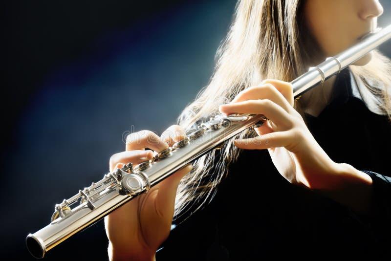 长笛乐器球员 免版税库存图片