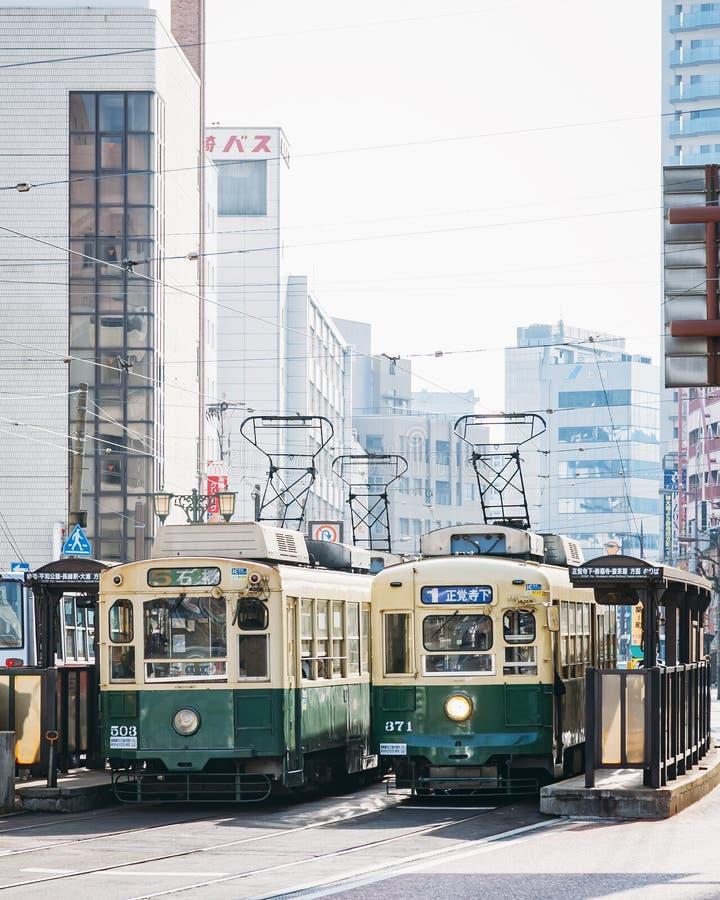 长崎,日本- 2012年2月23日:有电车铁路的长崎市 免版税库存照片