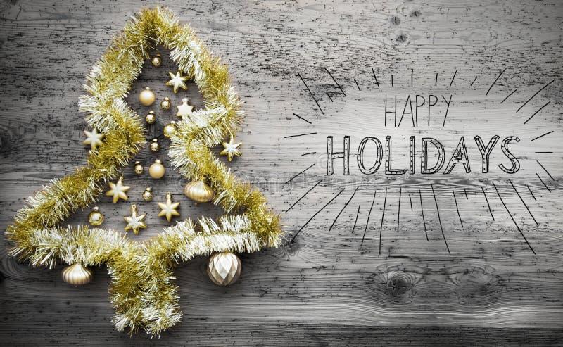 闪亮金属片圣诞树,书法文本节日快乐 免版税库存图片