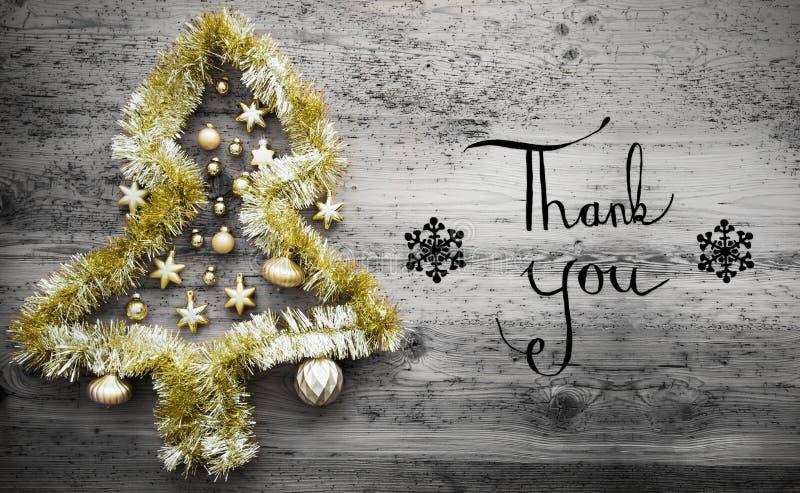 闪亮金属片圣诞树,染黑书法,谢谢 库存图片