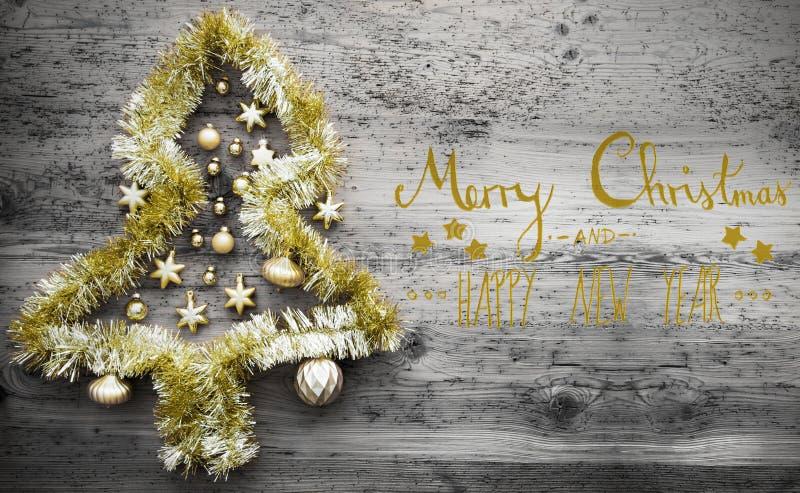 闪亮金属片树、书法、圣诞快乐和新年快乐 库存照片
