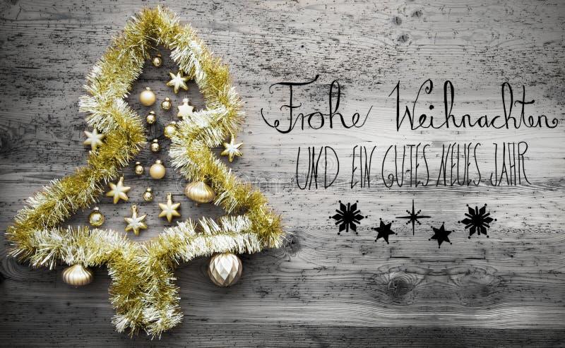 闪亮金属片树,黑书法, Gutes Neues意味新年快乐 库存照片