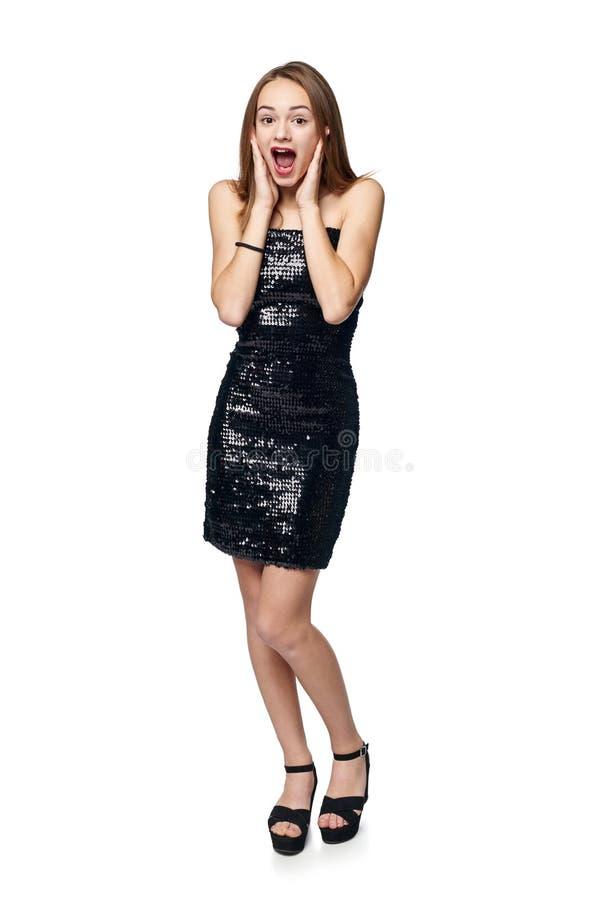 闪光金属片的礼服的惊奇的女孩 库存照片