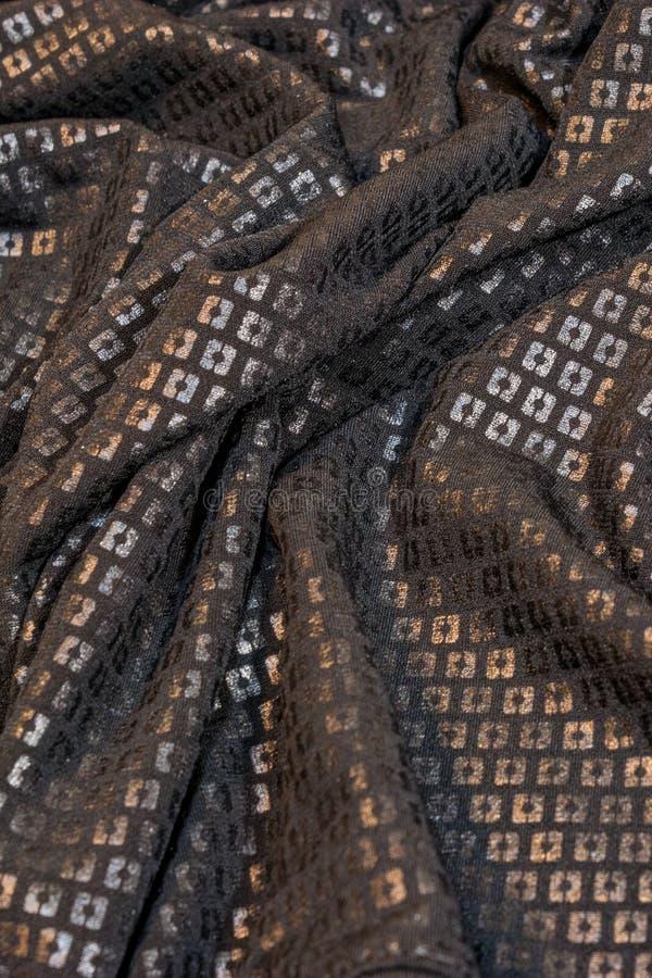闪光金属片的黑织品 免版税库存图片