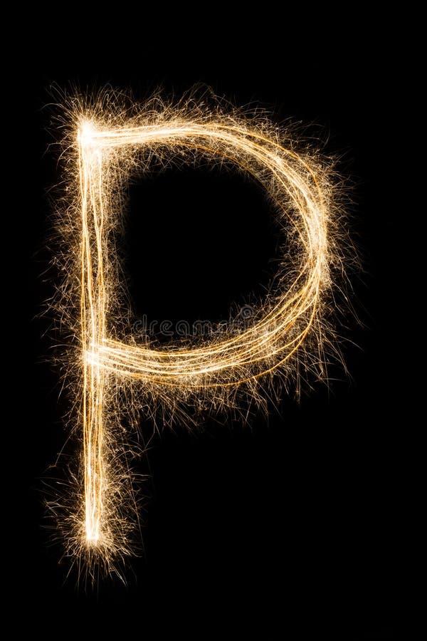 从闪烁发光物字母表的英国信件P在黑背景 库存照片